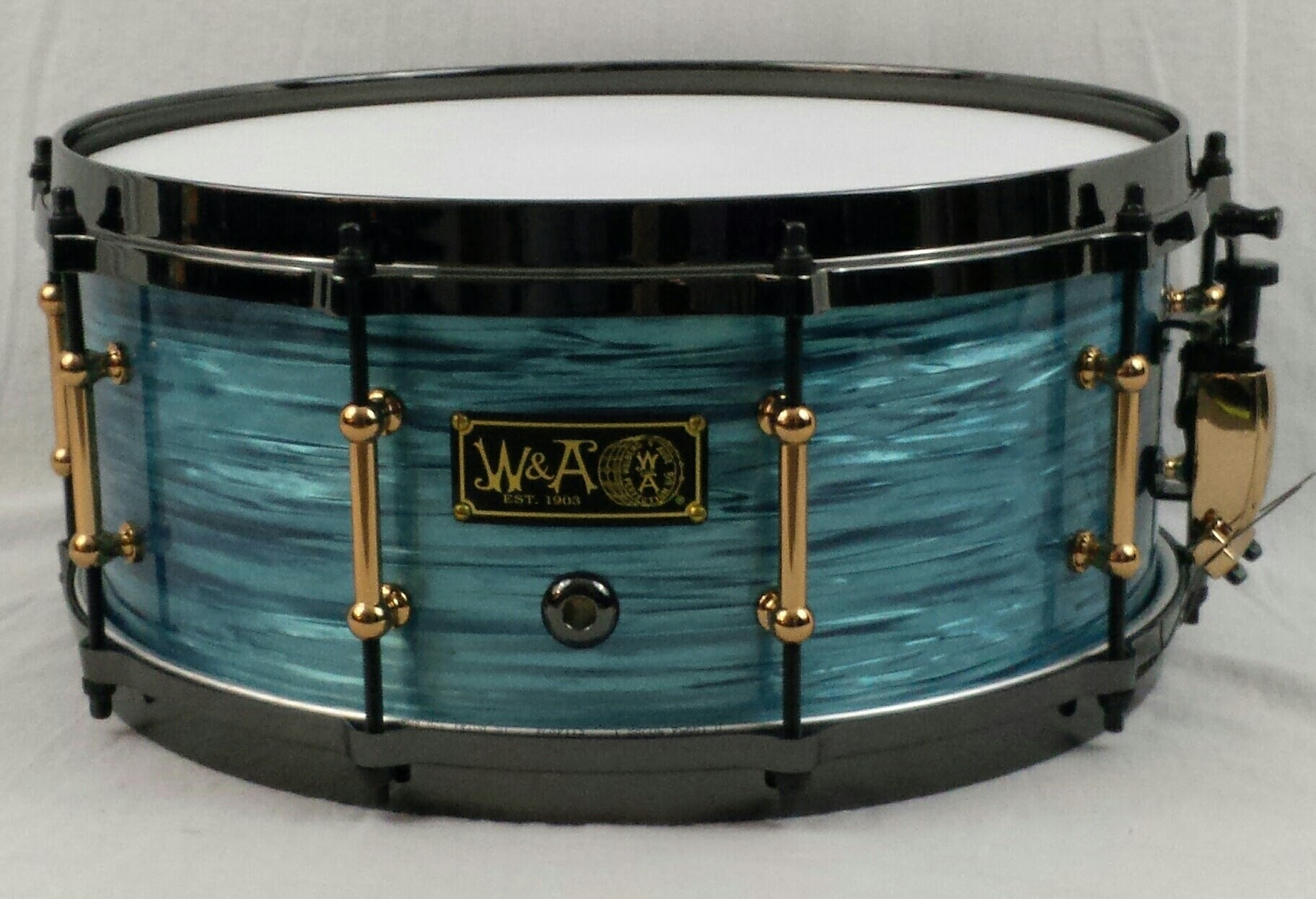 6x14 10ply Maple Shell wraped in turquoise rippleimage.jpg